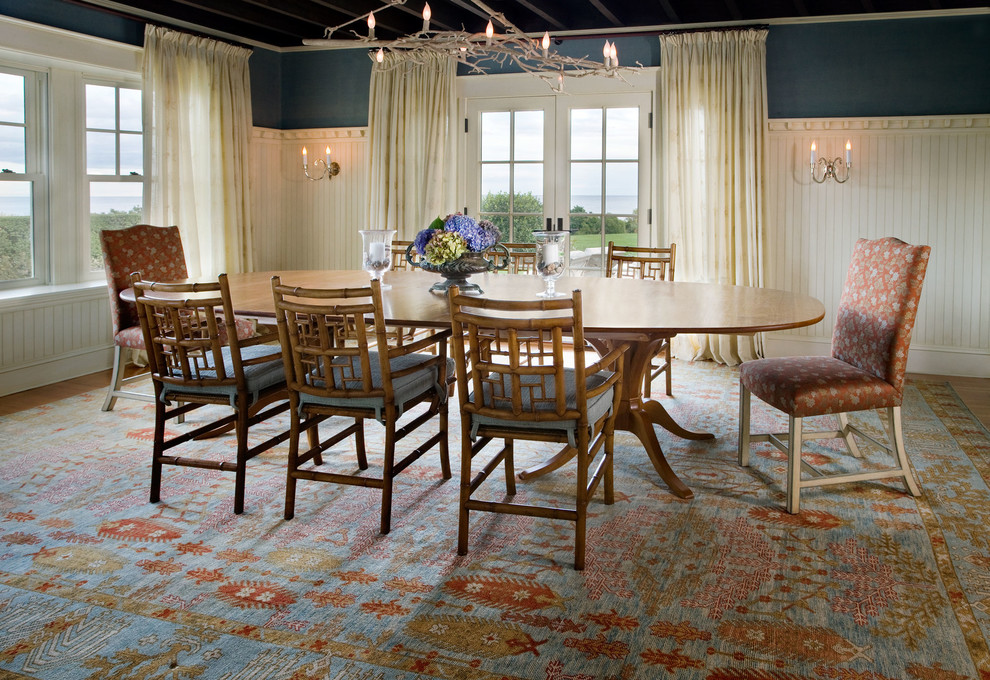 Large elegant medium tone wood floor enclosed dining room photo in Boston with blue walls and no fireplace