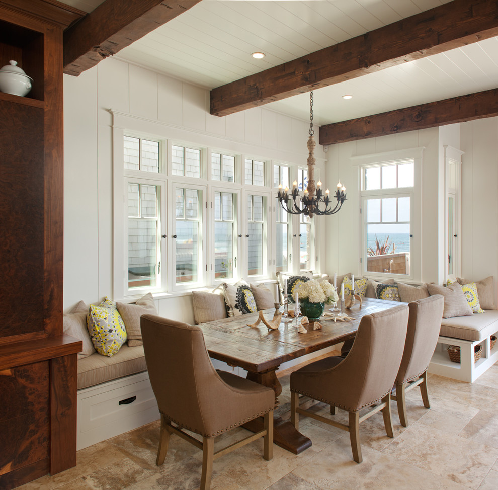 Example of a beach style dining room design in San Diego with white walls