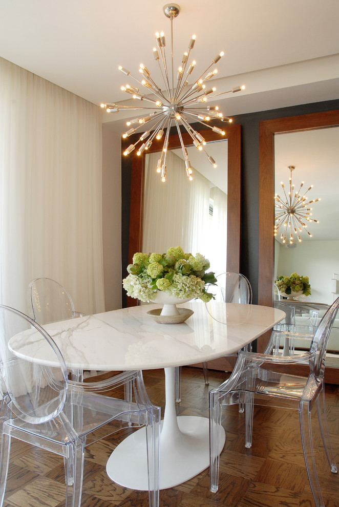 Dining room - transitional medium tone wood floor dining room idea in Los Angeles with beige walls