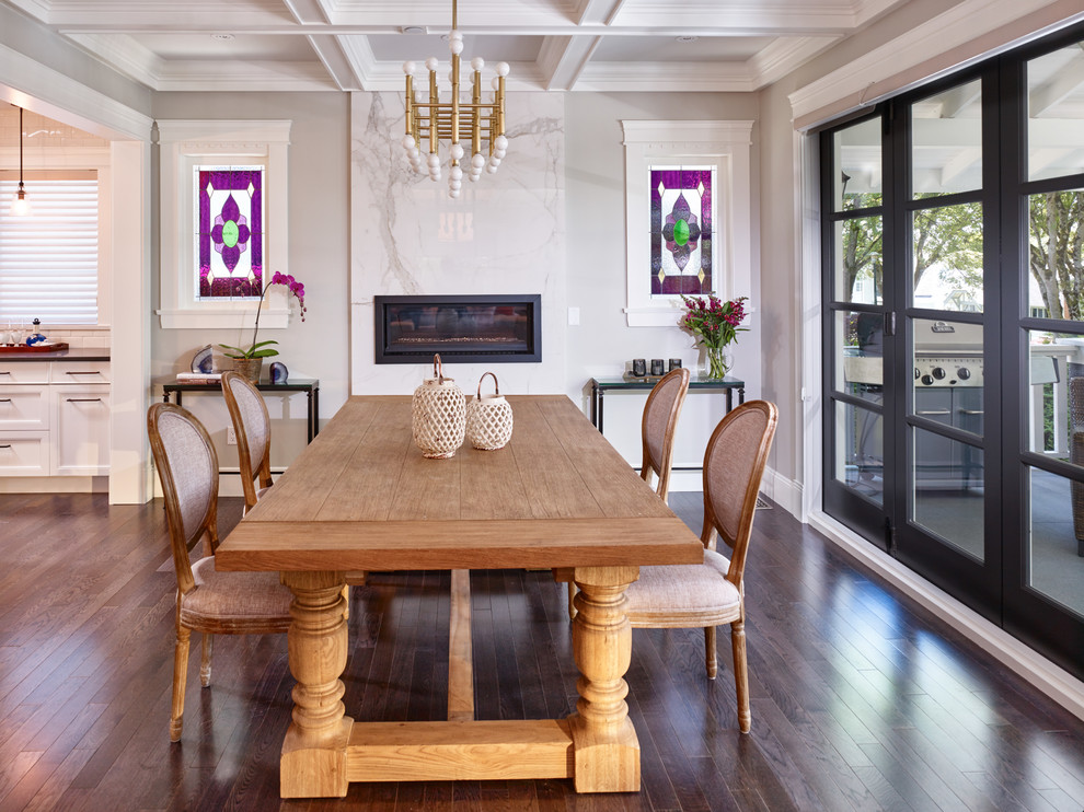 Inspiration for a transitional dark wood floor dining room remodel in Vancouver with gray walls, a ribbon fireplace and a stone fireplace
