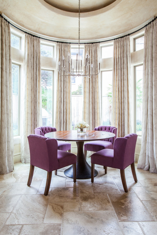 Example of a transitional dining room design in Houston with beige walls and no fireplace