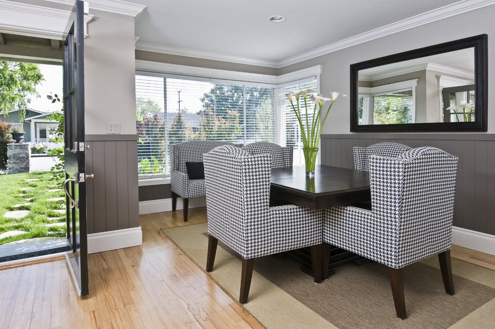 Trendy light wood floor dining room photo in Orange County with gray walls