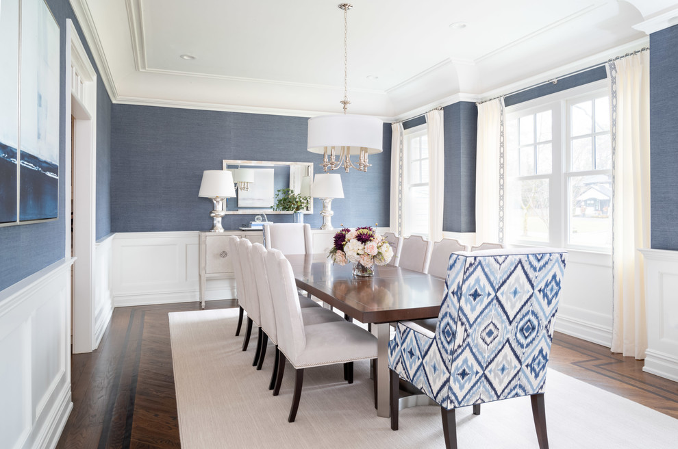 Transitional dark wood floor and brown floor dining room photo in New York with blue walls