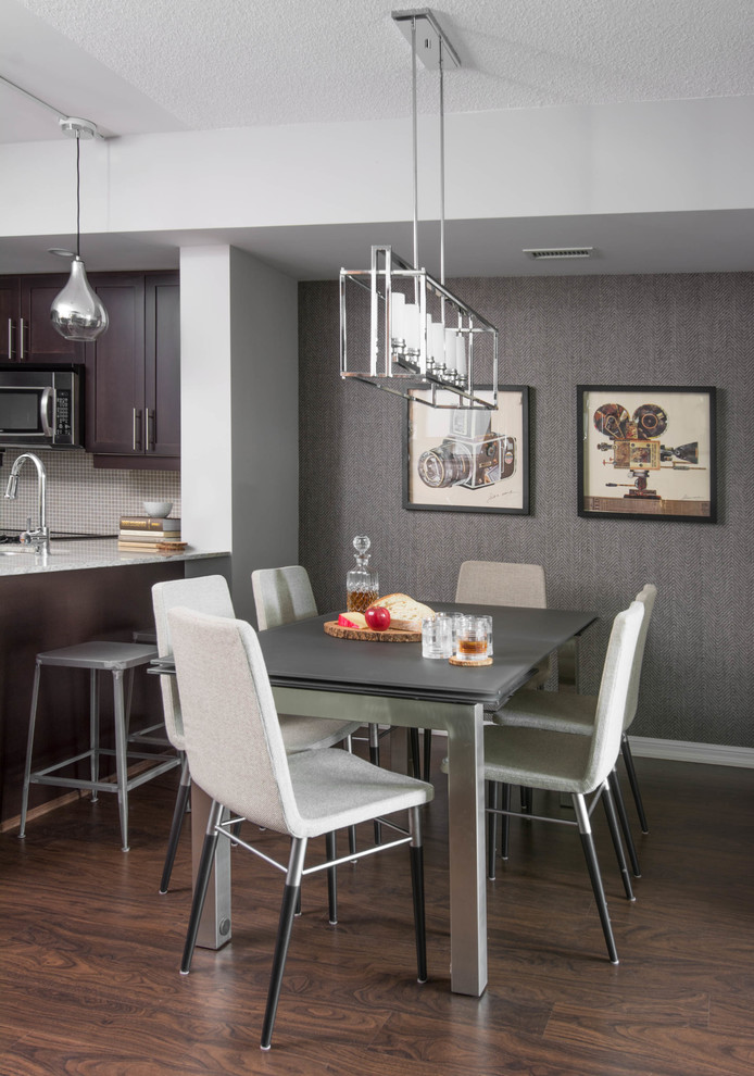 Inspiration for a small contemporary dark wood floor and brown floor kitchen/dining room combo remodel in Toronto with gray walls and no fireplace