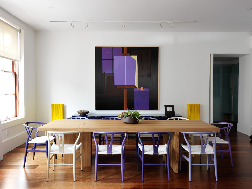 Inspiration for a large contemporary medium tone wood floor dining room remodel in New York with white walls