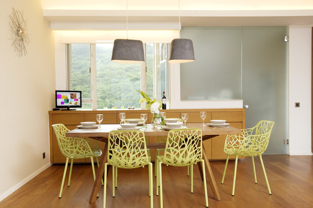 tropical dining room by Clifton Leung Design Workshop