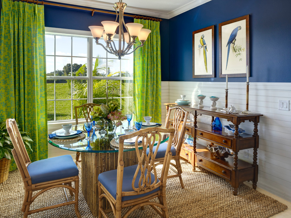 Dining room - tropical dining room idea in Tampa with blue walls