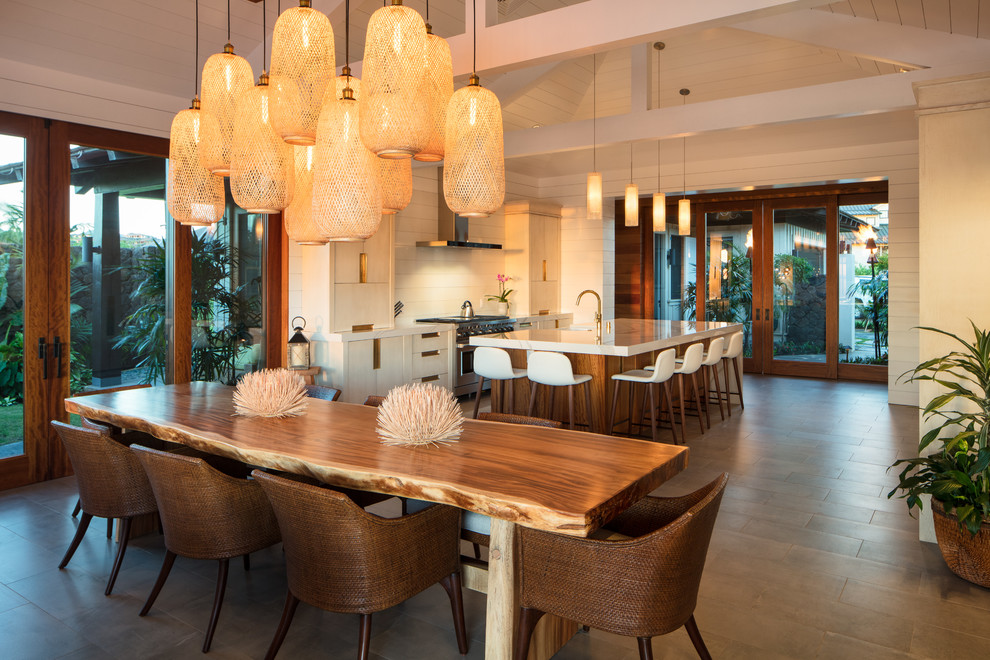 Example of a mid-sized island style gray floor and ceramic floor kitchen/dining room combo design in Hawaii with white walls