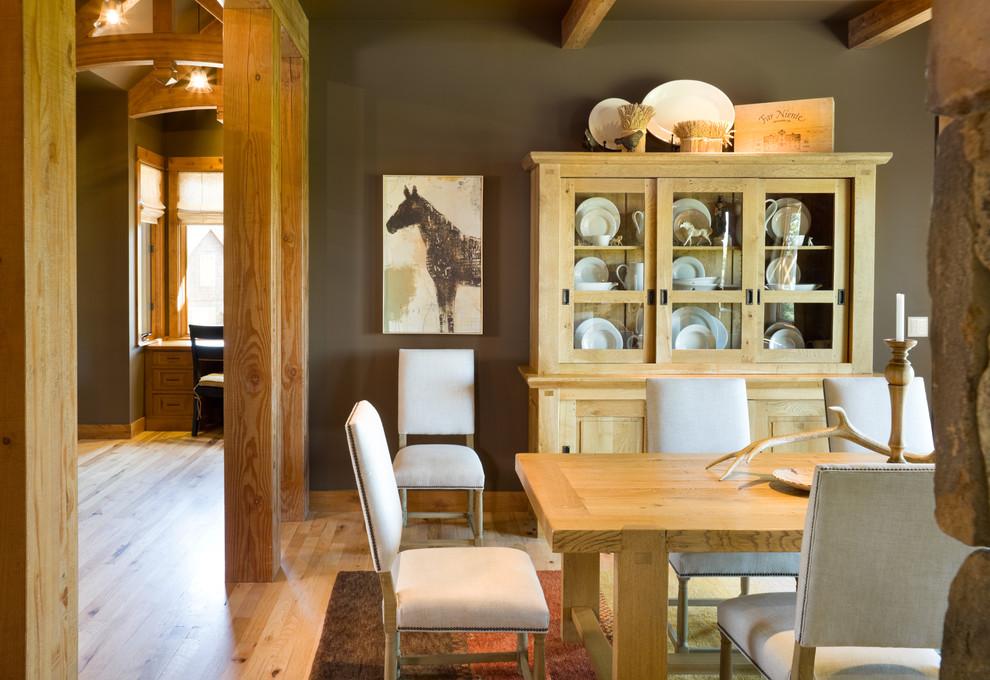 Dining room - rustic medium tone wood floor dining room idea in Portland with brown walls