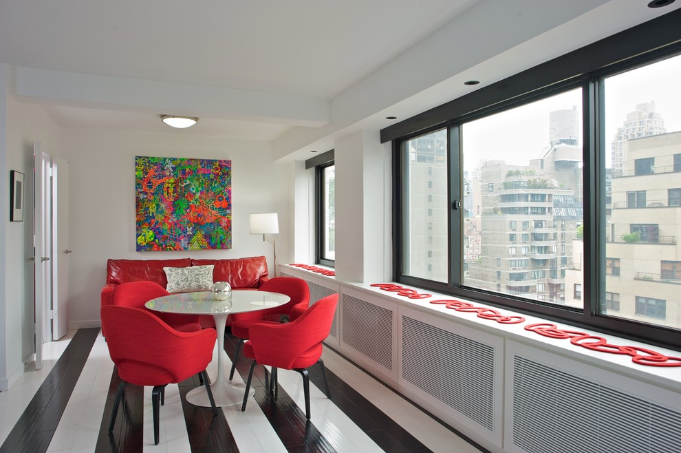 Example of a mid-sized trendy painted wood floor and multicolored floor enclosed dining room design in New York with white walls and no fireplace