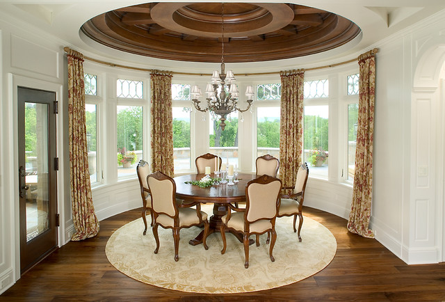 Two creeks expansive estate traditional dining room for Symmetry in interior design