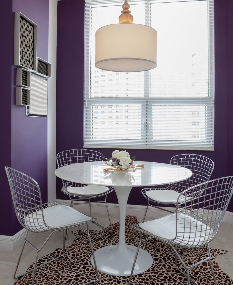Example of a trendy dining room design in Miami with purple walls