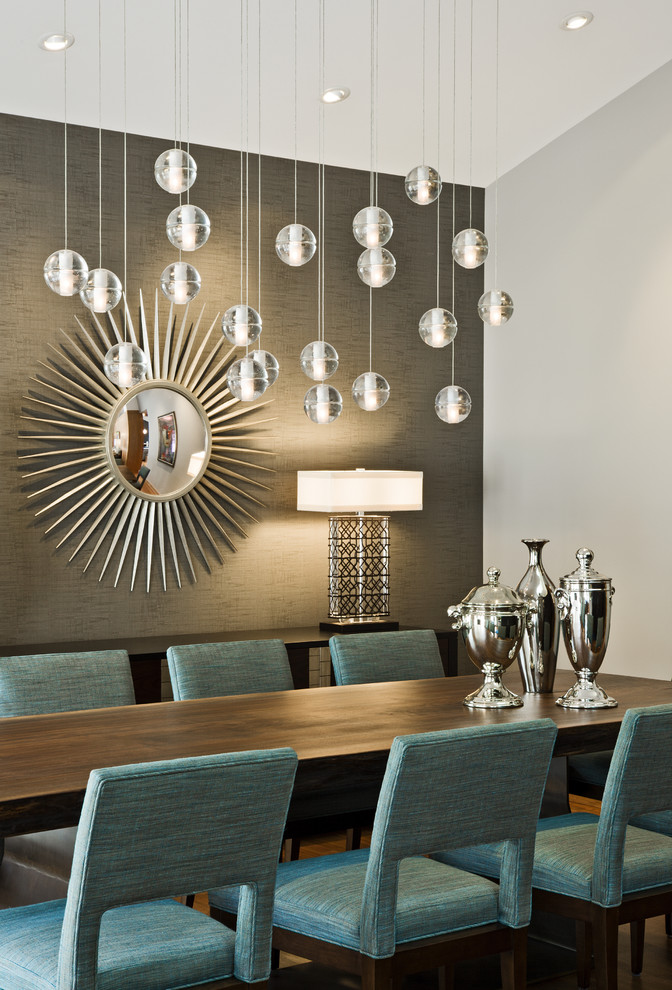 Example of a mid-century modern dining room design in Minneapolis with gray walls