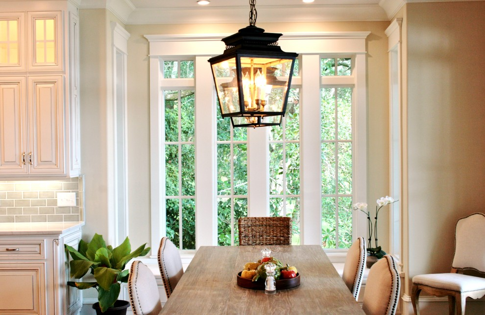 Inspiration for a light wood floor kitchen/dining room combo remodel in Miami with beige walls and no fireplace