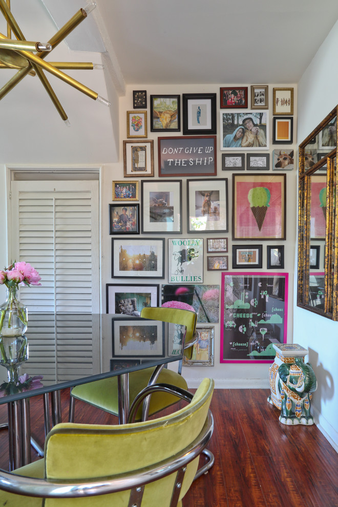 Inspiration for an eclectic dark wood floor dining room remodel in Los Angeles with white walls
