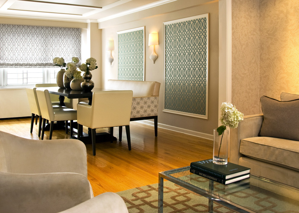 Example of a trendy medium tone wood floor dining room design in New York with beige walls