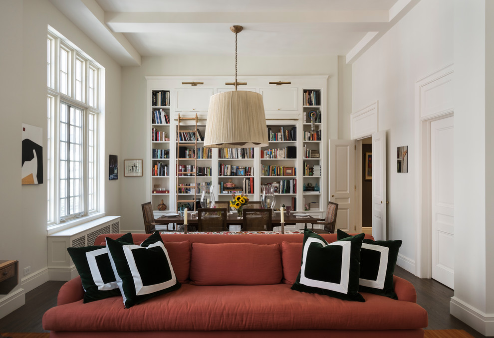 Inspiration for a mid-sized timeless dark wood floor and brown floor great room remodel in New York with white walls, a standard fireplace and a wood fireplace surround