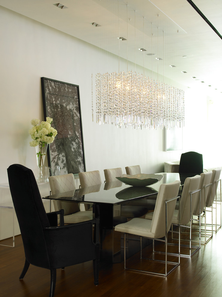 Dining room - contemporary dark wood floor dining room idea in New York with white walls