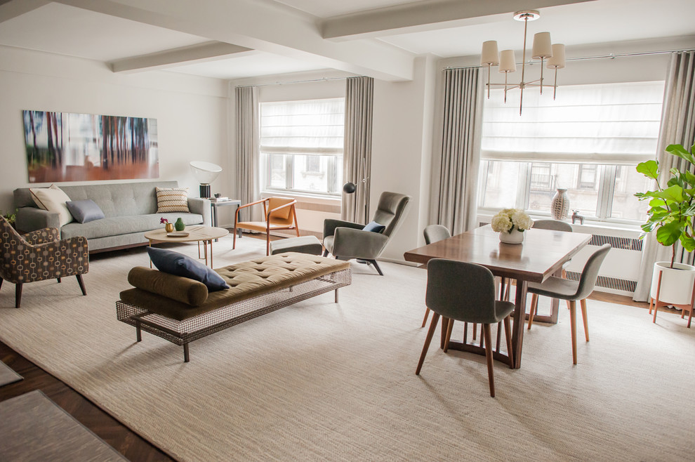 Inspiration for a mid-sized transitional dark wood floor and brown floor great room remodel in New York with gray walls and no fireplace
