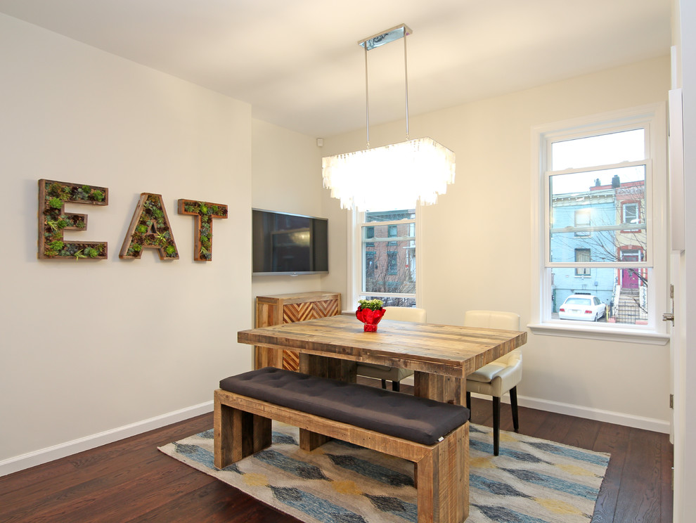 Transitional dark wood floor dining room photo in New York with white walls and no fireplace