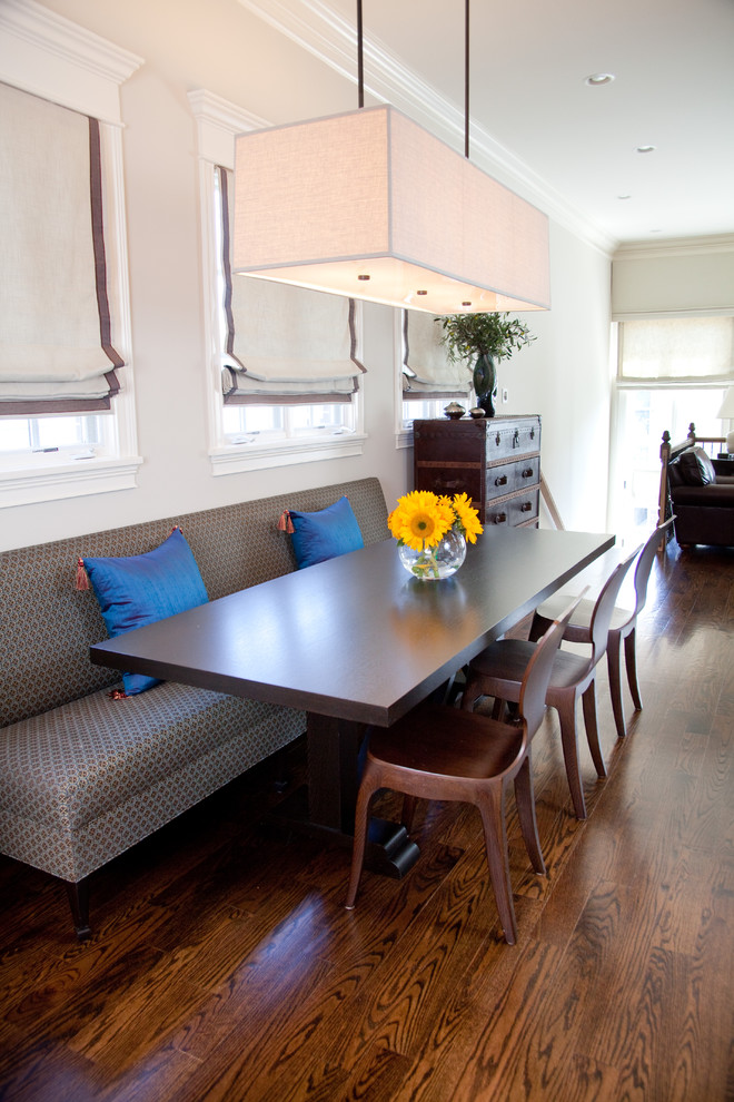 Dining room - transitional dark wood floor dining room idea in Chicago with white walls