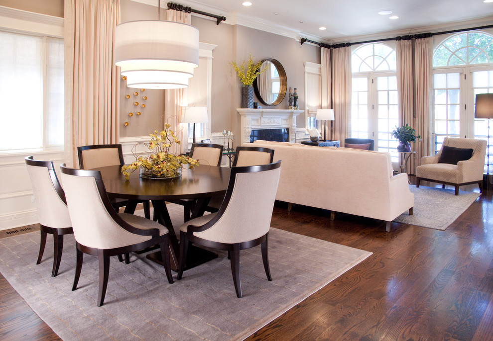 Inspiration for a medium sized traditional open plan dining room in Chicago with brown floors, beige walls, dark hardwood flooring and no fireplace.