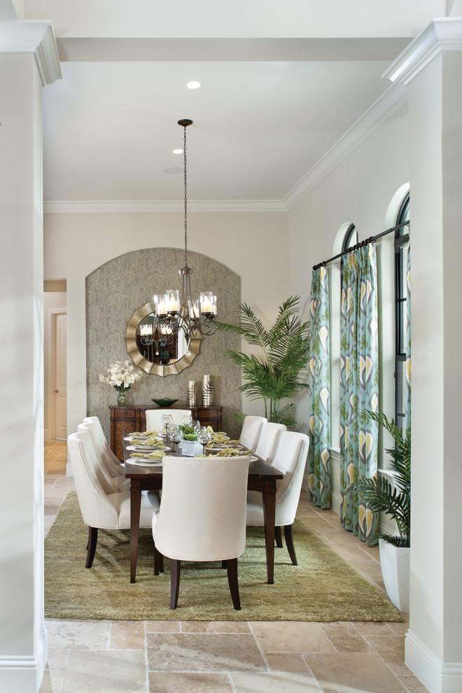 Tuscan dining room photo in Tampa with beige walls