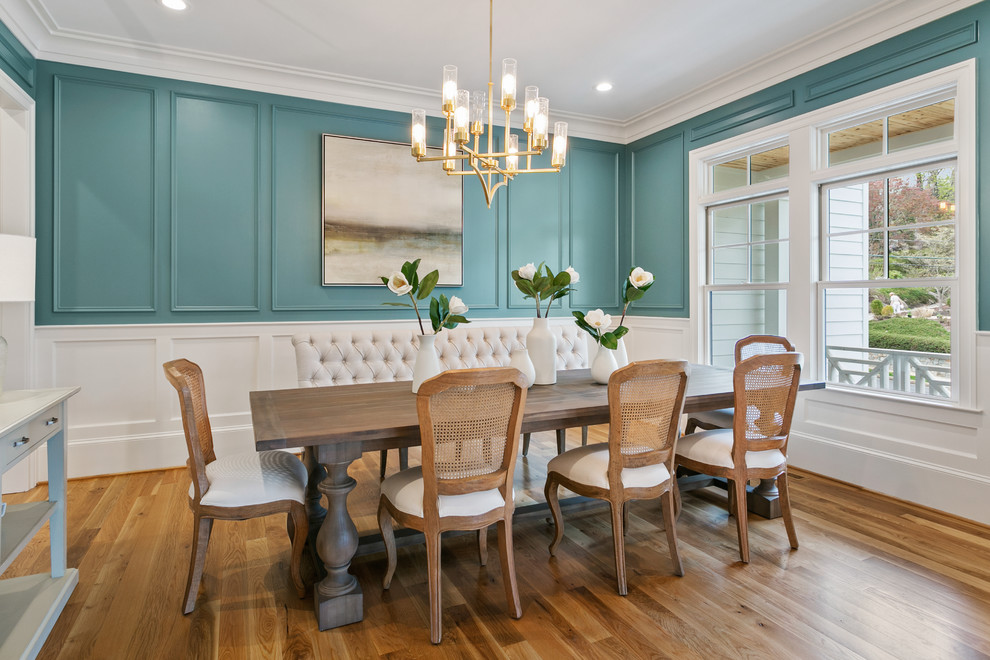 Mid-sized transitional medium tone wood floor and brown floor enclosed dining room photo in Other with blue walls