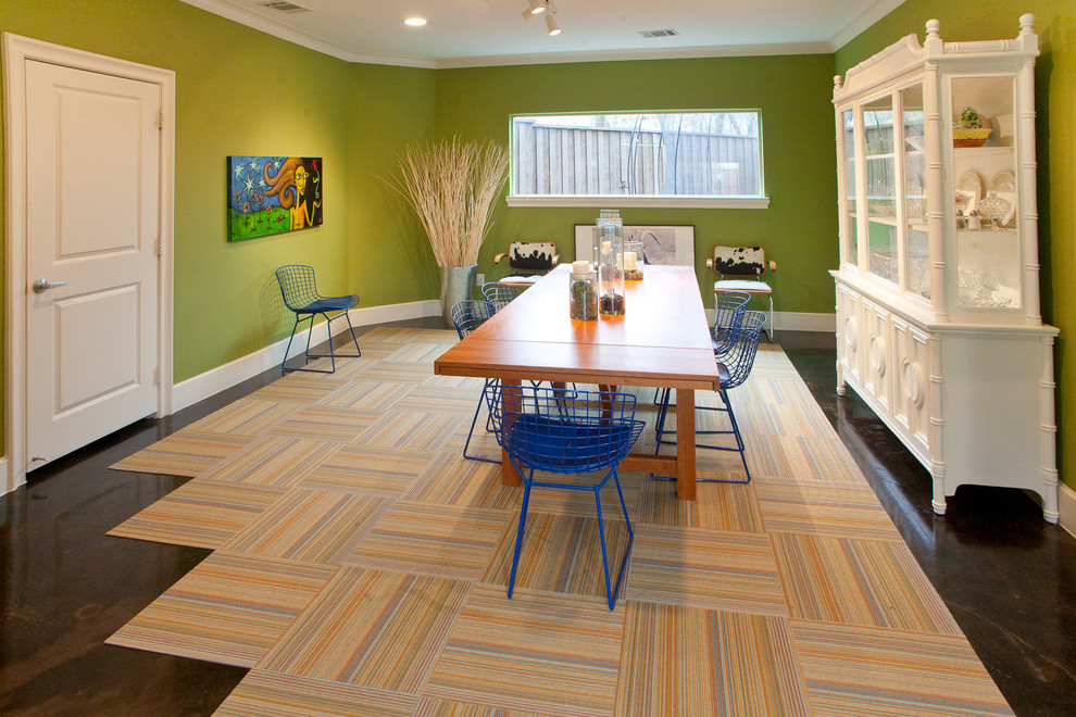Minimalist dining room photo in Dallas with green walls