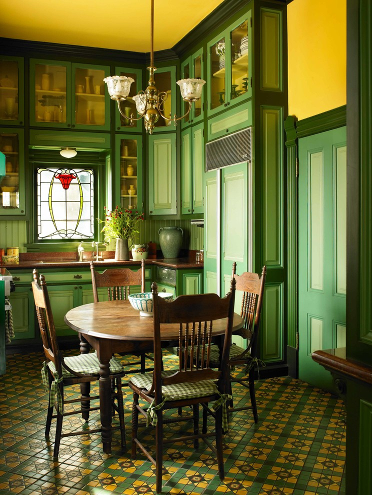 Kitchen/dining room combo - small victorian ceramic tile and multicolored floor kitchen/dining room combo idea in Los Angeles with yellow walls