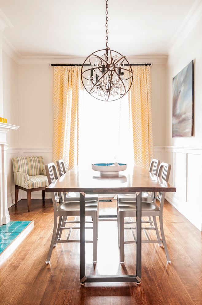 Dining room - transitional dark wood floor dining room idea in Toronto with white walls and a standard fireplace