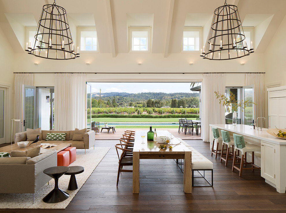 Example of a trendy dark wood floor great room design in San Francisco with white walls