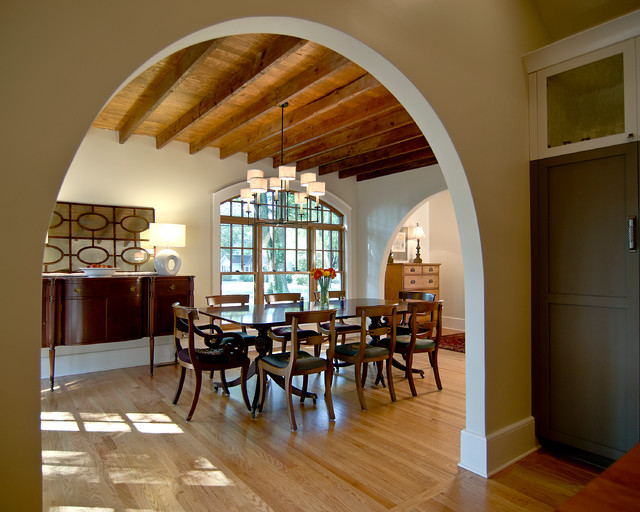 Example Of A Large Tuscan Light Wood Floor And Brown Enclosed Dining Room Design In
