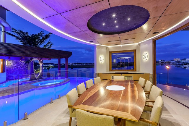 Waterfront House - Pelican Waters contemporary-dining-room