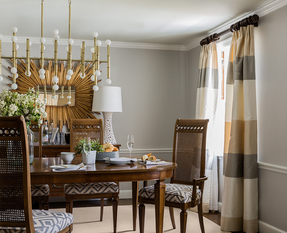 Example of a trendy dark wood floor dining room design in Boston with gray walls