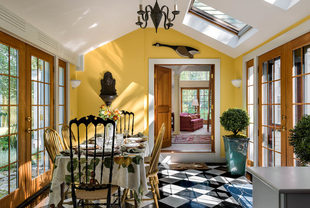 Enclosed dining room - mid-sized country marble floor enclosed dining room idea in Portland Maine with yellow walls