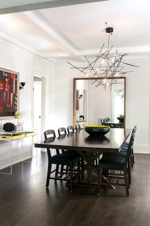 Dining Room With Wooden Table And Chairs A Modern Light Fixture