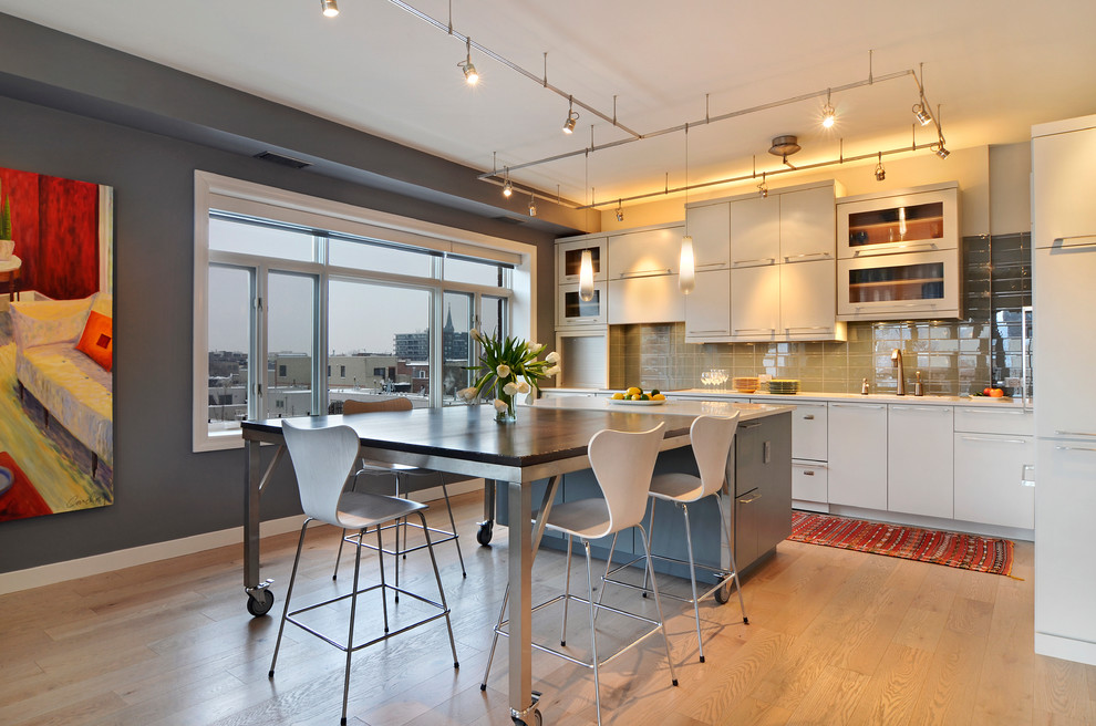 Kitchen/dining room combo - mid-sized contemporary light wood floor and brown floor kitchen/dining room combo idea in Chicago with gray walls and no fireplace