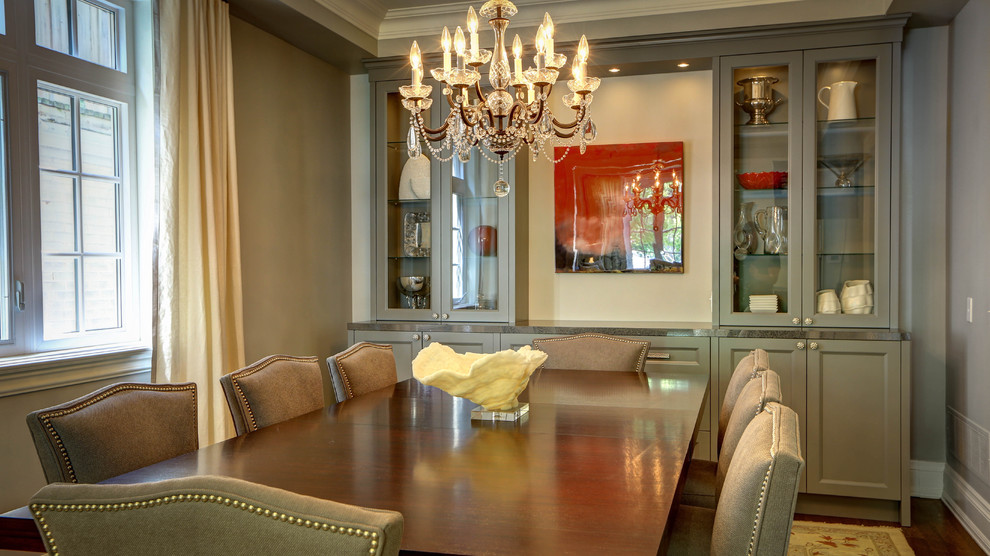 Inspiration for a timeless dark wood floor dining room remodel in Toronto with gray walls