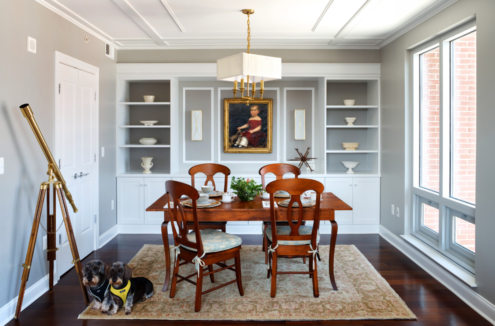 Inspiration for a timeless dark wood floor enclosed dining room remodel in DC Metro with gray walls