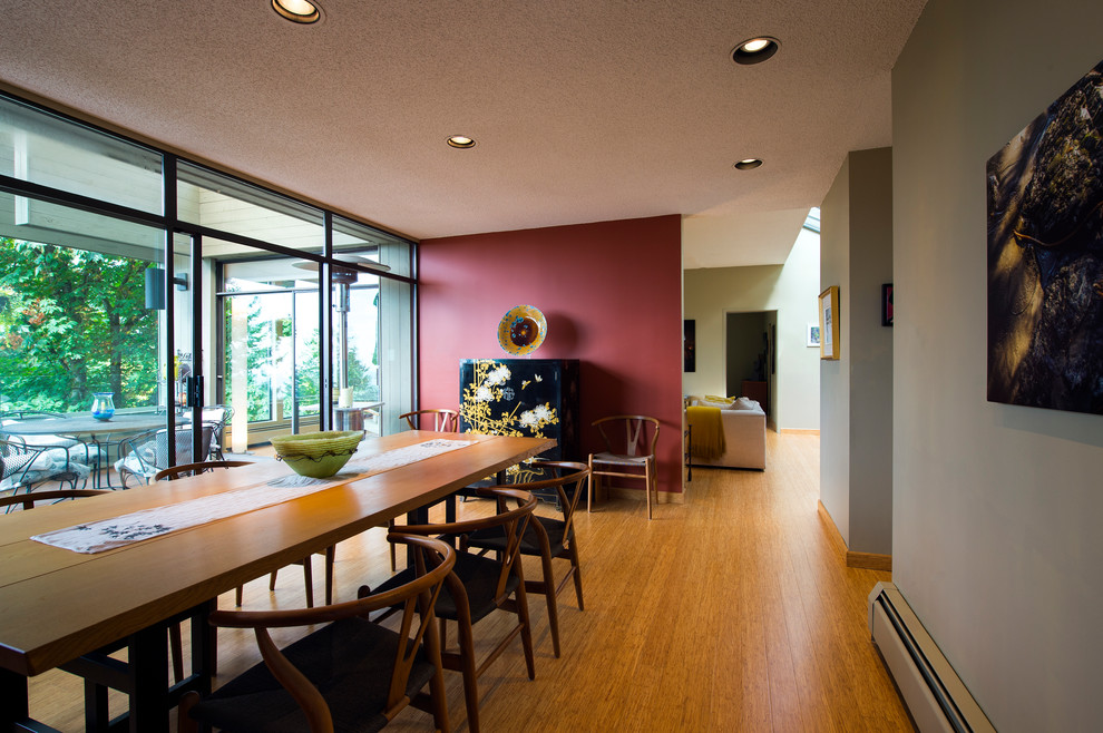 Mid-sized minimalist bamboo floor and beige floor enclosed dining room photo in Vancouver with red walls and no fireplace