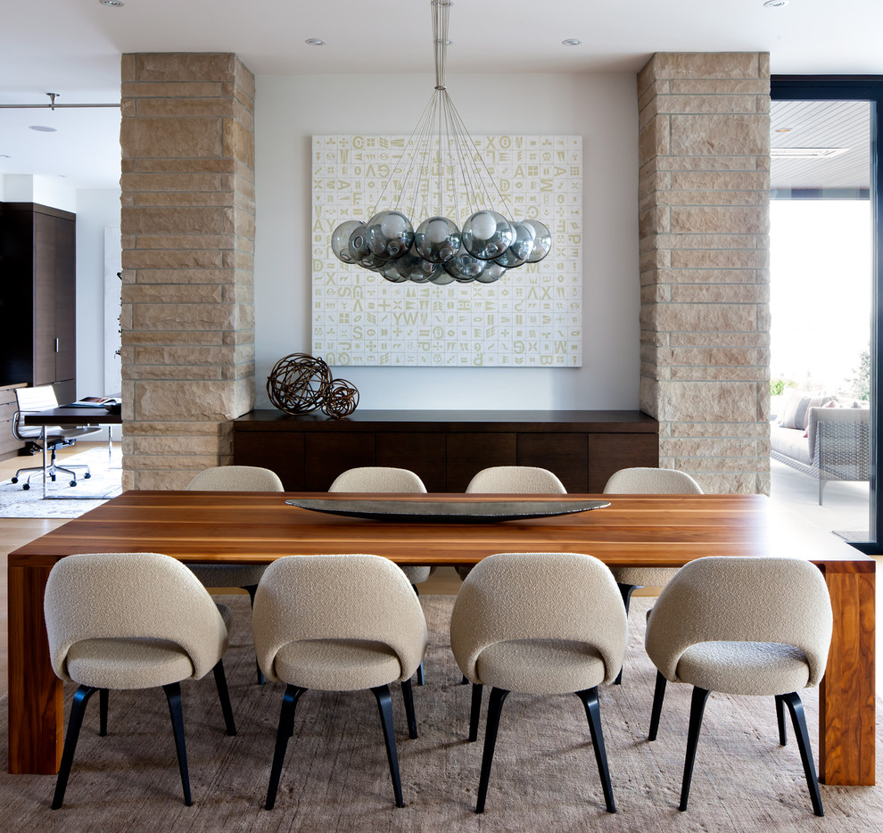 Trendy dining room photo in Vancouver with white walls