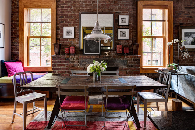 Example of an eclectic dining room design in New York