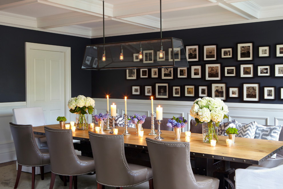 Transitional enclosed dining room photo in New York with black walls