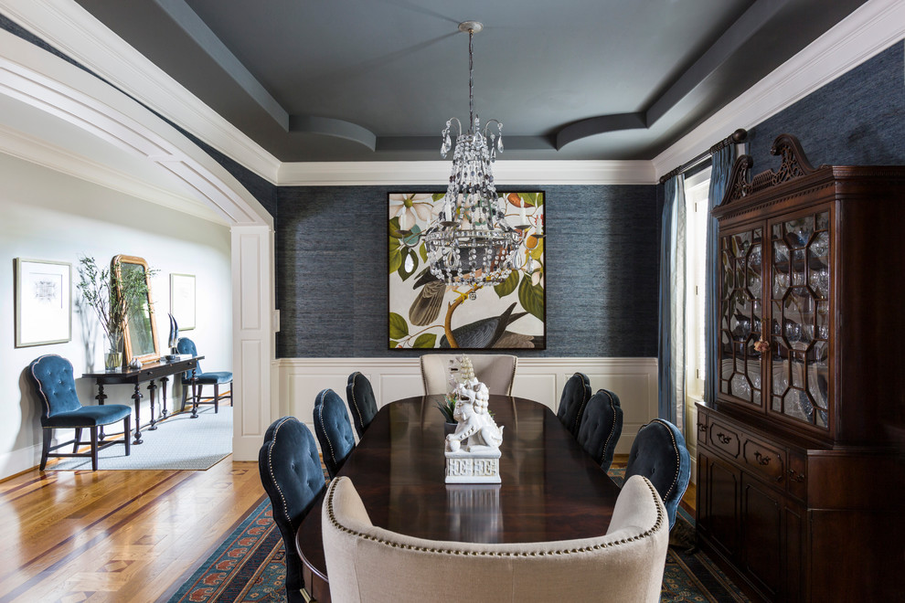 Example of a mid-sized classic medium tone wood floor and brown floor enclosed dining room design in Houston with gray walls and no fireplace
