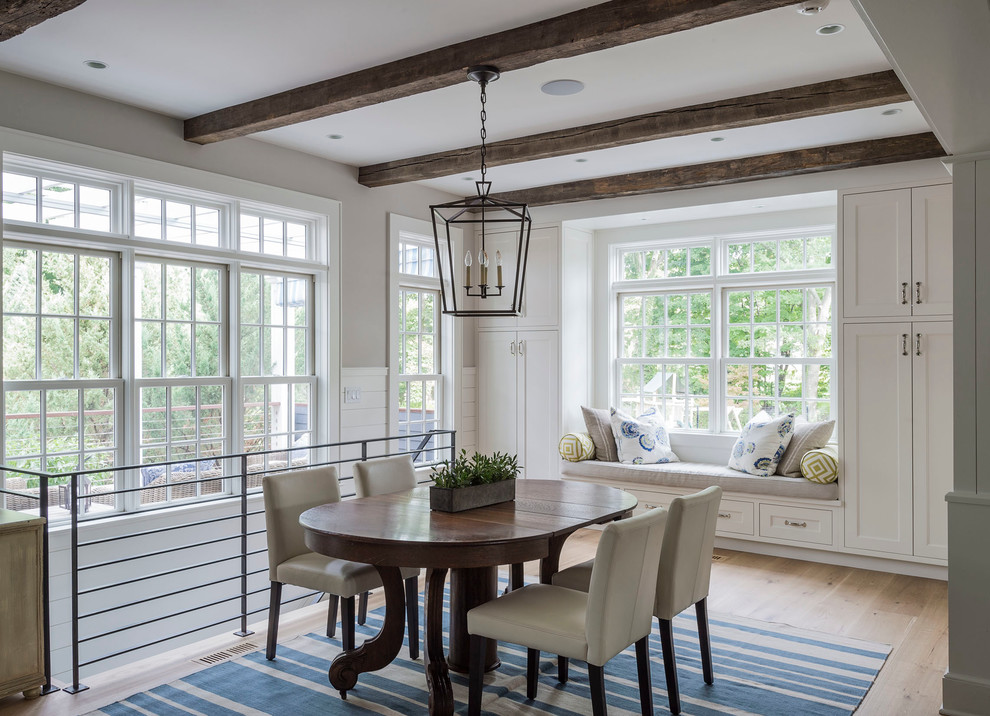Inspiration for a mid-sized farmhouse medium tone wood floor kitchen/dining room combo remodel in New York with white walls