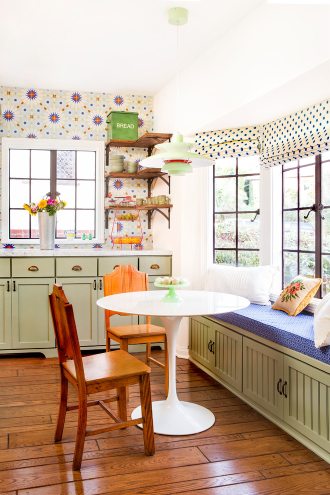 Kitchen/dining room combo - mid-sized cottage medium tone wood floor and brown floor kitchen/dining room combo idea in Los Angeles with white walls