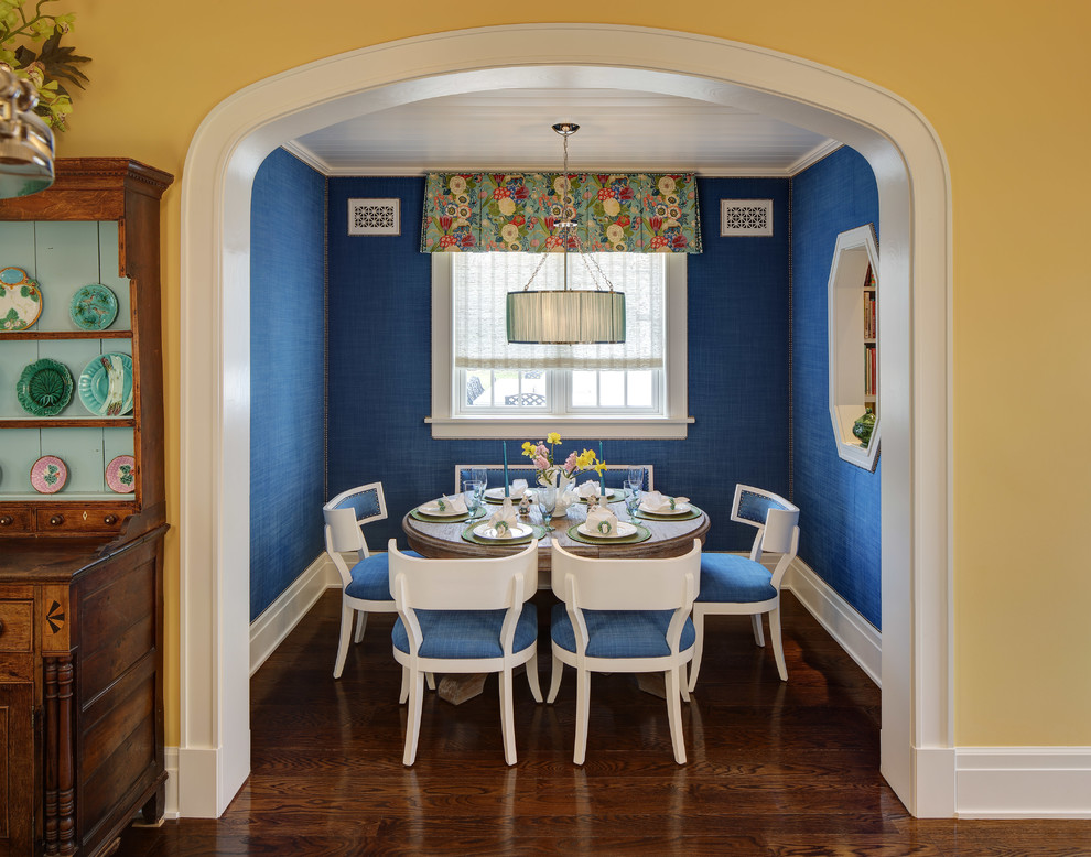 Example of a classic dark wood floor and brown floor enclosed dining room design in Chicago with blue walls and no fireplace