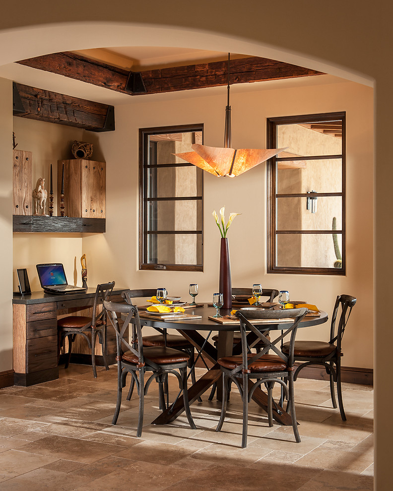 Example of a southwest dining room design in Phoenix with beige walls