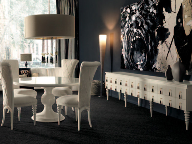 White round dining table in a dark dining room